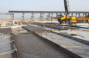 Precast panels are constructed off-site, then transported and installed on a prepared base.
