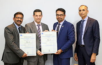 Al Shirawi Contracting officials receive the certificate from Lloyd's Register.