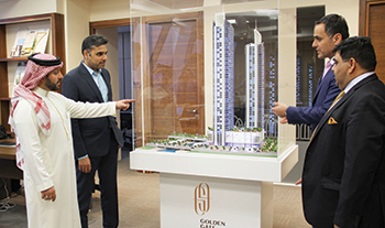FROM LEFT: Al Kooheji and Ajmera highlight the features of Golden Gate to HCE  officials.