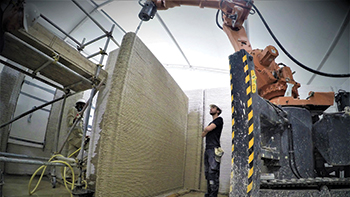 The printer's ABB robotic arm is placed on a moveable crawler.