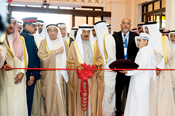 Bahrain's Prime Minister cuts the ribbon to open the three exhibitions.