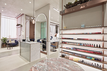 Lighting at the salon is tailored to each area including brighter sections in retail shelving areas and the hair styling zone.