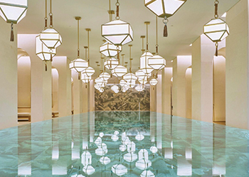 The indoor swimming pool ... based on a modern colonnade, lit by dozens of lanterns.