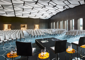 Al Mirqab Ballroom features broadly arched ceiling of reinforced plaster in a faceted, geometric pattern.