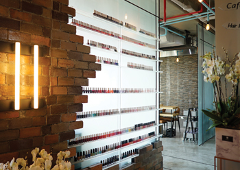 Nail polish shelves combine bricks with glass.