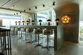 Lighting is provided by authentic steel hangar lights and lamps made from jet engines.