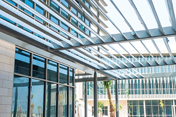 Academic buildings have horizontal and vertical sunshade louvres for energy efficiency.