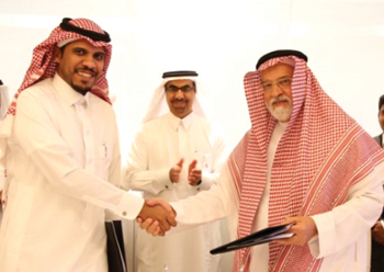 Alfanar and Taqnia Energy officials shake hands on the deal.