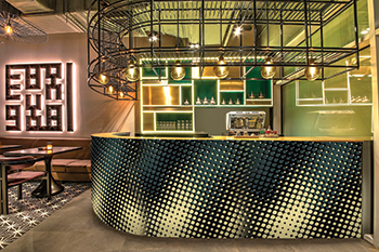 The bar with a black metal cage fascia and a façade mimicking mesh perforations.