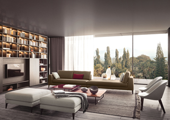 The Spazioteca bookcase with TV panel acts as a backdrop to the Time sofa.