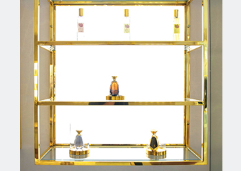 The dedicated fragrance section of the store is separated from the clothing area with an ivory and gold partition.