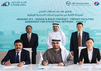 Officials sign the deal for the Etihad Rail contract.