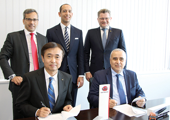 Zahid Tractor and UD Trucks officials at the signing ceremony.