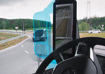 Actros with MirrorCam ... by eliminating the classic mirror, it provides a full view through the side window. The marked area illustrates the visual gain.
