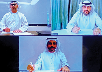 ADPower and Tadweer officials ink the agreement remotely.
