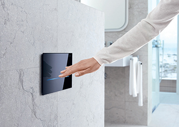Geberit WC flush controls can be actuated automatically by a hand motion near the visible IR sensor.