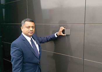 Manoj Thomas, Project Manager Passive Fire Protection at Al Semsam, demonstrates that even after 15 years there is no colour variation of Trespa panels.