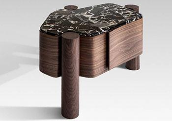 Villa ... bedside table on three legs.