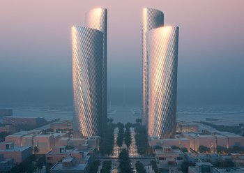 The tower façades are designed in response to the sun with projecting profiles that wrap around the building, shading the glazing from the harsh sun.