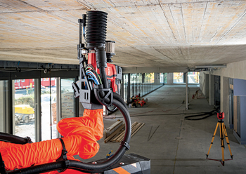 Using digital plans, the Jaibot marks and drills holes, relieving workers from the task of overhead drilling.