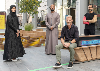 Wiles poses on one of the Covid-proof benches which were displayed at Dubai Design Week. He is seen here with the Emirati designers.