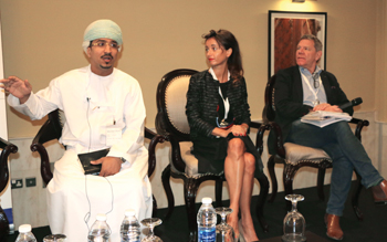 Almuhrzi (left) speaks at the SDiB conference in Muscat.