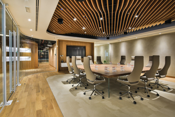 Curved wooden ceiling panels and wooden oak floors ... inspired by Dubai's shifting sand dunes.