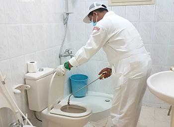 A Masa technician applying chemical spray.