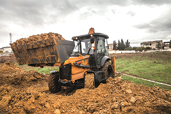 The Case 570ST 4x4 tractor backhoe loader ... giving 97 hp.