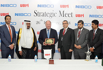 UBM officials receive the award from Nibco's chairman for outstanding sales performance.