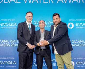 Khan (right) ... receiving the award.