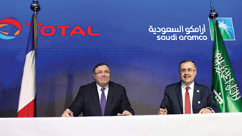 Total and Aramco officials sign the deal for the petrochemical complex.