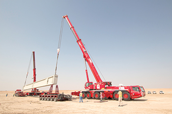 Impressive lifting capacities ... the Demag AC 300-6 all-terrain cranes working in tandem.