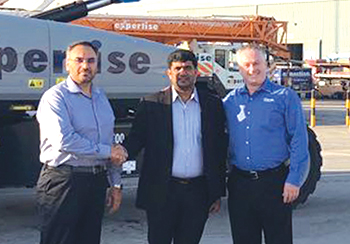 FROM LEFT: Ajmal, Ashraf, and Cooke, following the delivery of the units.
