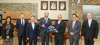 Alba and Siemens officials mark the milestone.