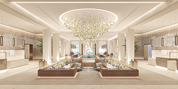 The main lobby ... a spectacular glass light fitting hangs above the 'Majlis' seating area.