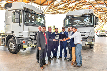 Al Haddad Motors and Agility officials at the handing over ceremony of the Actros trucks.