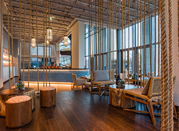 The beach club features bamboo and rope ceilings and arabesque lanterns.
