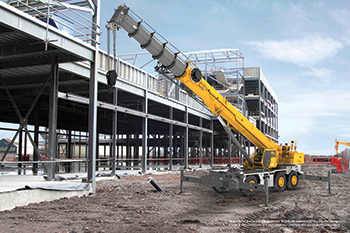 The Grove GRT9165 by Manitowoc ... the latest in its line of rough-terrain cranes.