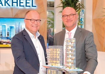 Officials from Nakheel and Bauer shake hands on the deal for Palm360.