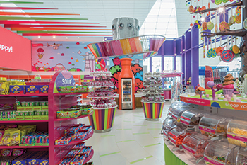 Candylicious at Dubai airport ... a bottle-shaped fridge and the Colourful Awning are key design features.