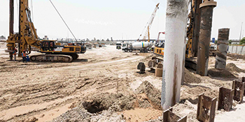 Piling work for the 17-storey Farhad Azizi Residence (right) has been completed.