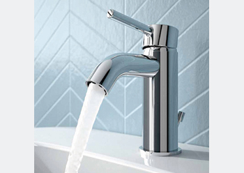 Cylindrical beauty ... the Ceraline range of bathroom mixers sets the trend.