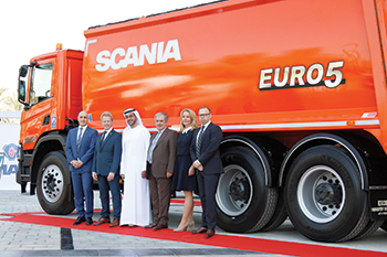 Scania officials with representatives from Al Shirawi.