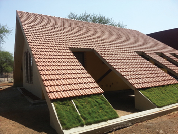 Sloped roofs guard against heat and rain.