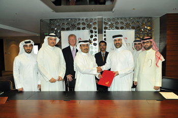 Diyar Al Muharraq and Bin Faqeeh officials shake hands on the Dragon Apartments agreement.