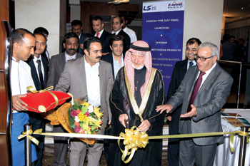 Ishaq cuts the ribbon at the ceremony.