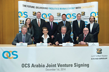 OCS and Zahid Group officials at the signing ceremony.