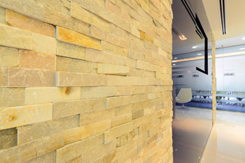 The stone wall feature in the reception area.