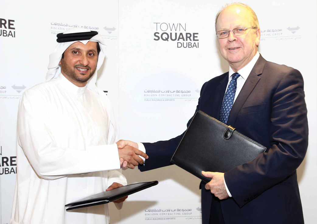 Mohamed Hashim Al Safi, director business development, Binladin Contracting Group, and Durie after signing the deep services contract for Phase One.